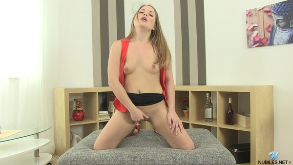Cute young woman -- rubs fingers pussy