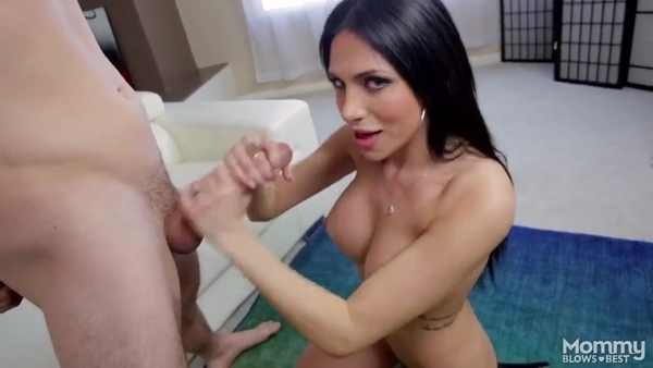 Brunette with silicone Boobs skillfully sucks penis