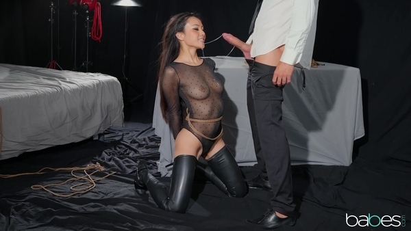 Dominates curvy Asian in latex stockings